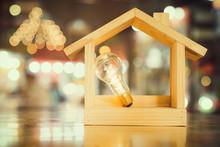 Light Bulb With Wood House On ...