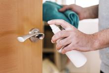 Hand Disinfecting A Doorknob W...