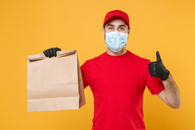 Delivery Man Employee In Red Cap Blank T-shirt Uniform Mask Glove Hold Craft Paper Packet With Food Isolated On Yellow Background Studio Service Quarantine Pandemic Coronavirus Virus 2019-ncov Concept