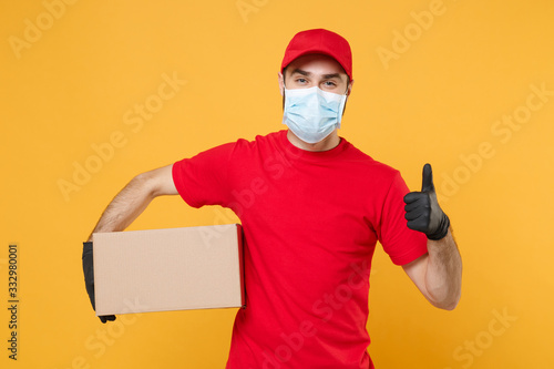 Delivery man employee in red cap blank t-shirt uniform face mask glove hold empt Canvas Print