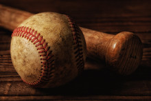 Closeup Of An Old Baseball And...