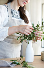 Woman Arranging Olive Branches...