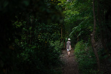 Unrecognizable Woman Walking In Dark Forest