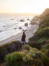 Young Women Cliff Near Ocean S...