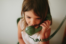 Girl Talks On Old School Phone