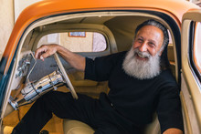 Lifestyle Portrait Of Happy Bearded Men In His Hot Rod Car