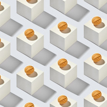 Creative Cubes Pattern With Walnuts Cakes On A Gray Background.