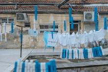 Linen Drying Near Shabby Building