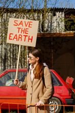 Woman With Ecological Placard Protesting On Street
