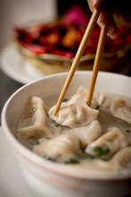 Hand Of Woman Eating Dumpling ...