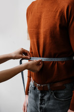 Seamstress Doing Measure Of Male Waist By Centimeter Tape