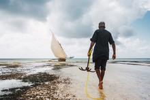 Fisherman Walking Towards The ...