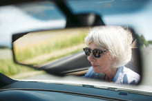 Relaxed Older Woman Driving Co...
