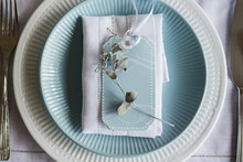 Table Setting With Blue Tag An...