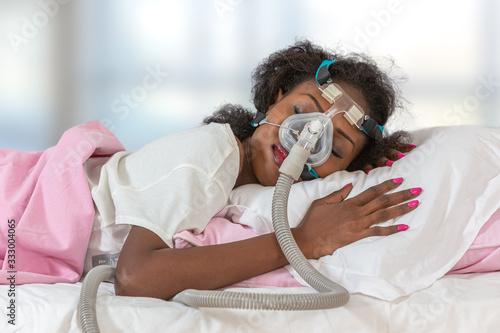 Woman wearing CPAP headgear to sleep against apnea Canvas Print