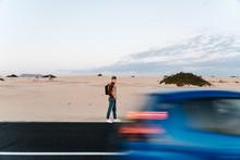 A Man Walking In The Desert.