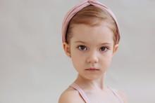 Closeup Portrait Of Little Serious Girl