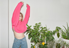 Crazy Teen Girl In Pink Top Dancing Near Lemon Tree.
