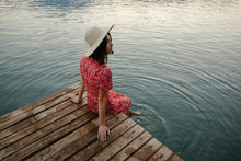 Woman Relaxing On The Boat Pier