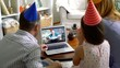 A family with a child congratulating a grandmother on her birthday using a video call. Home quarantine, social distancing, self isolation.