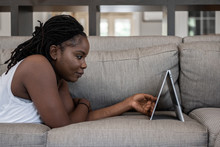 Woman Watching Tv On Her Device