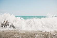 Wave Crashing Onto Shore
