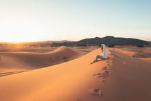 A European Woman In A Desert W...