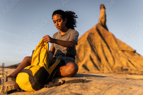 Traveler female african american doing camping on Navarra desert,