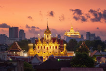 Loha Prasat Wat Ratchanatda And Golden Mountain Pagoda, A Buddhist Temple Or Wat Saket With Skyscraper Buildings In Bangkok Downtown, Urban City At Sunset, Thailand. Thai Landmark. Architecture.