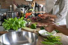 Women Preparing Vegetables In ...