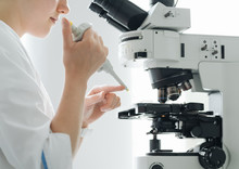 Person Working With Microscope...