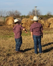 Two Little Cowboys In  A Pastu...