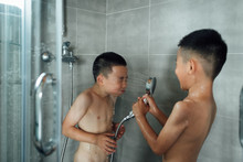 Two Boys Are Taking A Shower T...