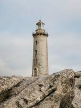 Old Lighthouse On Rocks