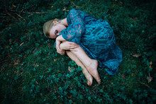 Woman Lying On The Grass In An...