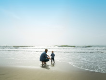 Father And Son On A Beach Day,...
