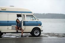 Teenage Girl Getting Into Vintage Van On Rainy Day