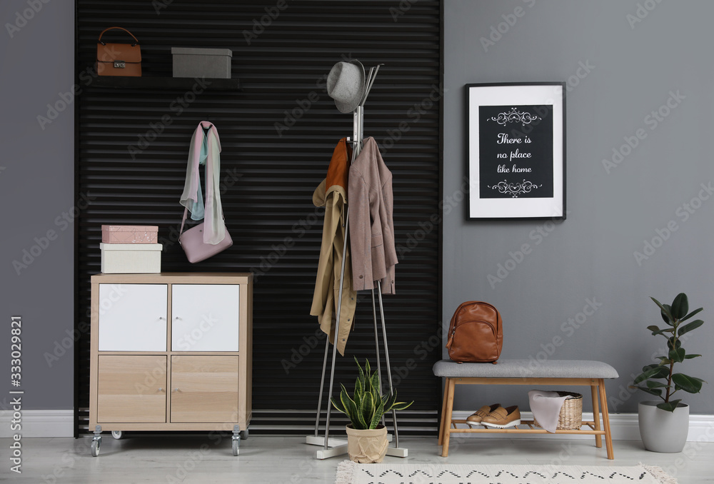 Fototapeta Hallway interior with stylish furniture, clothes and accessories