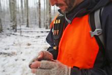 Male Hunter Checks His GPS Whi...