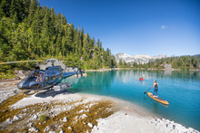 Mother And Daughter Paddling On Stunning Blue Lake During Tour.