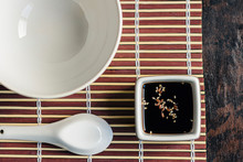 Vessel With Soy Sauce And Sesa...