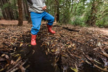 Young Child With Red Boots Sto...