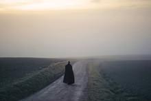 Woman With Long Coat Walks In ...