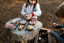 Children Playing Tic Tac Toe At Natural Outdoor Playground In Texas