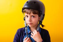 Portrait Of A Blonde Girl In A Skateboard Helmet