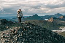 Photographer Hiking In Landmannalaugar