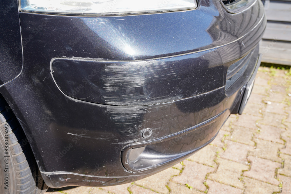 Fototapeta van bumper with scratch damaged broken car scratched paint in accident collision street