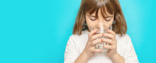 Child Girl Drinks Water From A...