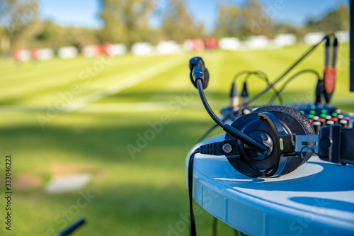Obraz na plátne commentator headsets on the table next to the football field