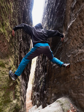 Boy Hold On The Rock. Man Clim...